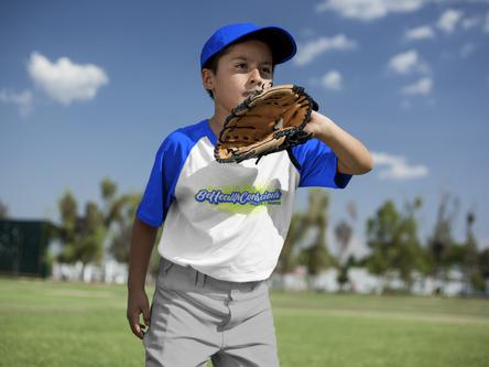 baseball-uniform-designer-boy-wearing-a-raglan-tee-mockup-about-to-catch-the-ball-a16378.p