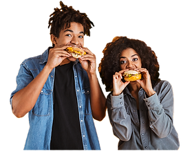 stock-photo-cheerful-young-african-couple-standing-isolated-over-orange-background-eating-