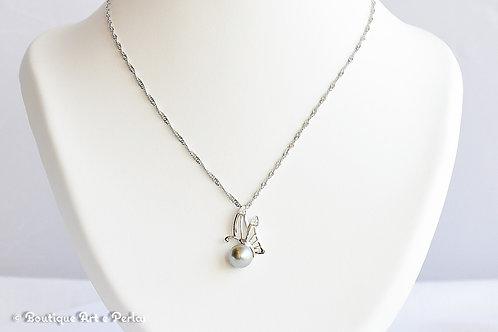 Cadena de plata con colgante mariposa y perla champagne