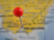 Pin marked Melbourne on map, Australia.j