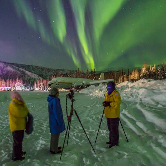 Photographers with tripods airstrip Aurora Borealis