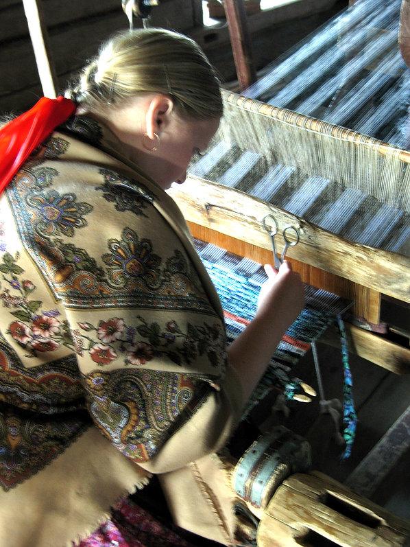 Kihzi, Russia - woman working a loom