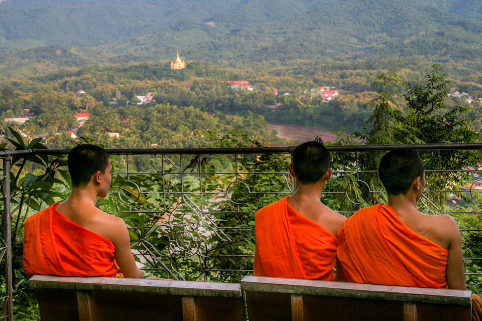 Monks sitting overlooking Luang Prabang