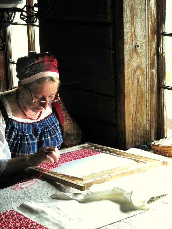 Kihzi, Russia woman at needlepoint with side lighting
