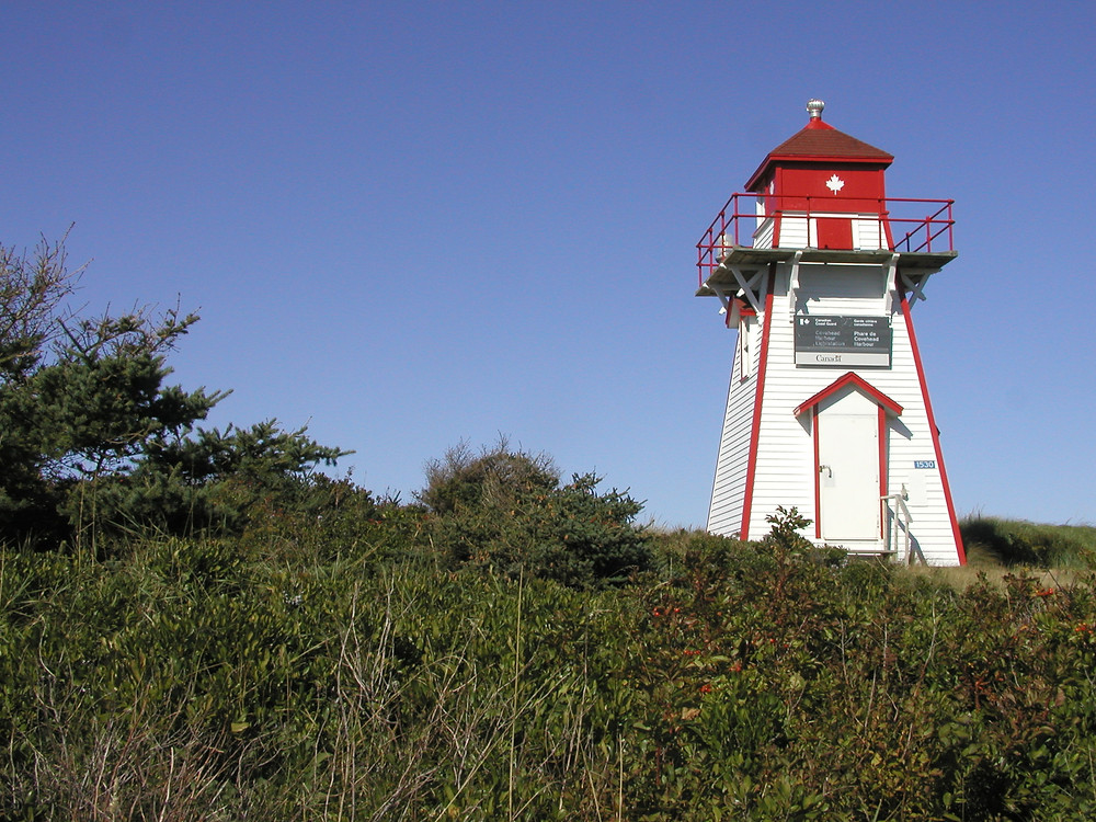 Short red and white wooden lighthouse