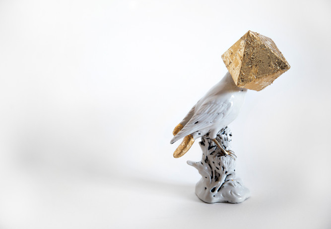 Jenny Kendler Camouflage XLII (Kintsugi for the endangered Yellow-billed Cotinga), 2021 vintage porcelain bird, salvaged styrofoam, paperclay, gold leaf, archival bookbinder's glue 6 1/4 x 5 x 3 in.