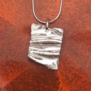 Carol Brook Silverfish square ribbon pendant