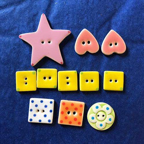 A set of 11 handmade ceramic buttons