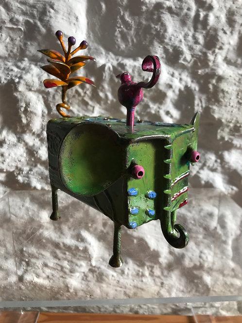 Luka's scrap- metal elephant music box