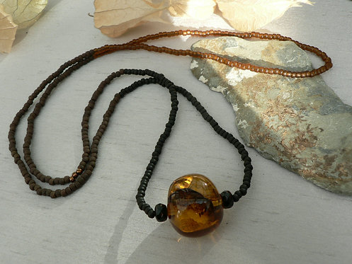 Sam Hemming long glass bead necklace with large amber bead