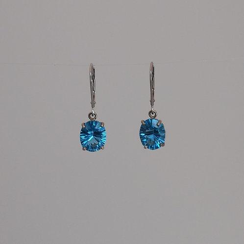 Earrings fantasy cut blue topaz in white gold.