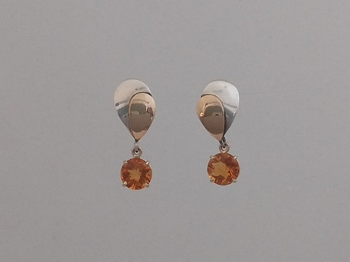 Earrings citrine in yellow gold and silver.