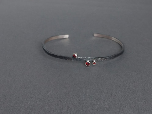 Bangle sterling silver with red garnets by Eva Stone