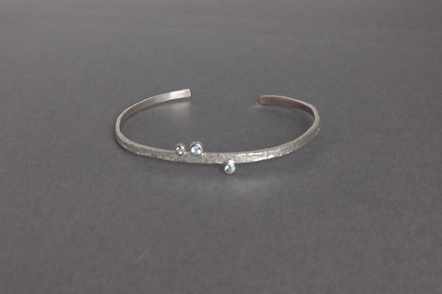 Bangle sterling silver with blue topaz by Eva Stone