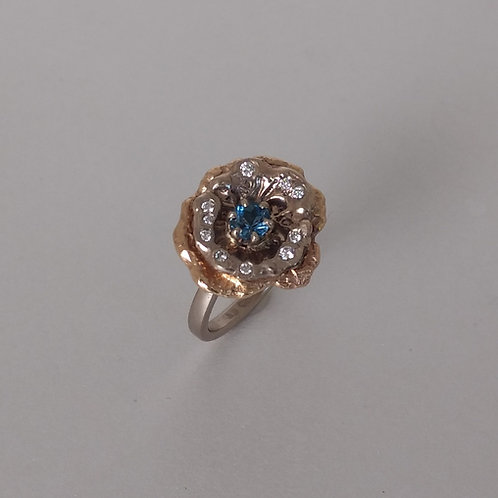 Ring aquamarine in a flower