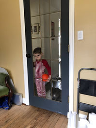 child behind door image.jpg