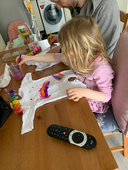 Maisie uses some fabric paints!