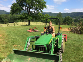 Melissa on the tractor in the upper pasture