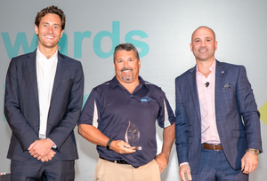 Brian Atkinson, center, accepting the Corporate Technical Leadership award from SolarWinds MSP.