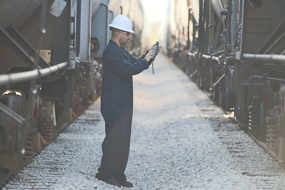 Rail operator scanning an Automatic Equipment Identification (AEI) tag with an INT300 mobile AEI tablet.