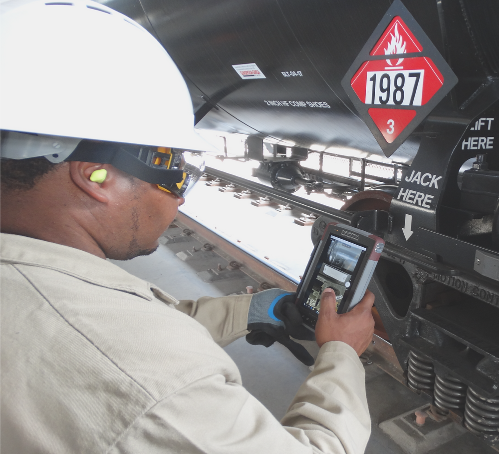 Operator taking a photo with his INT300 Mobile AEI Tablet