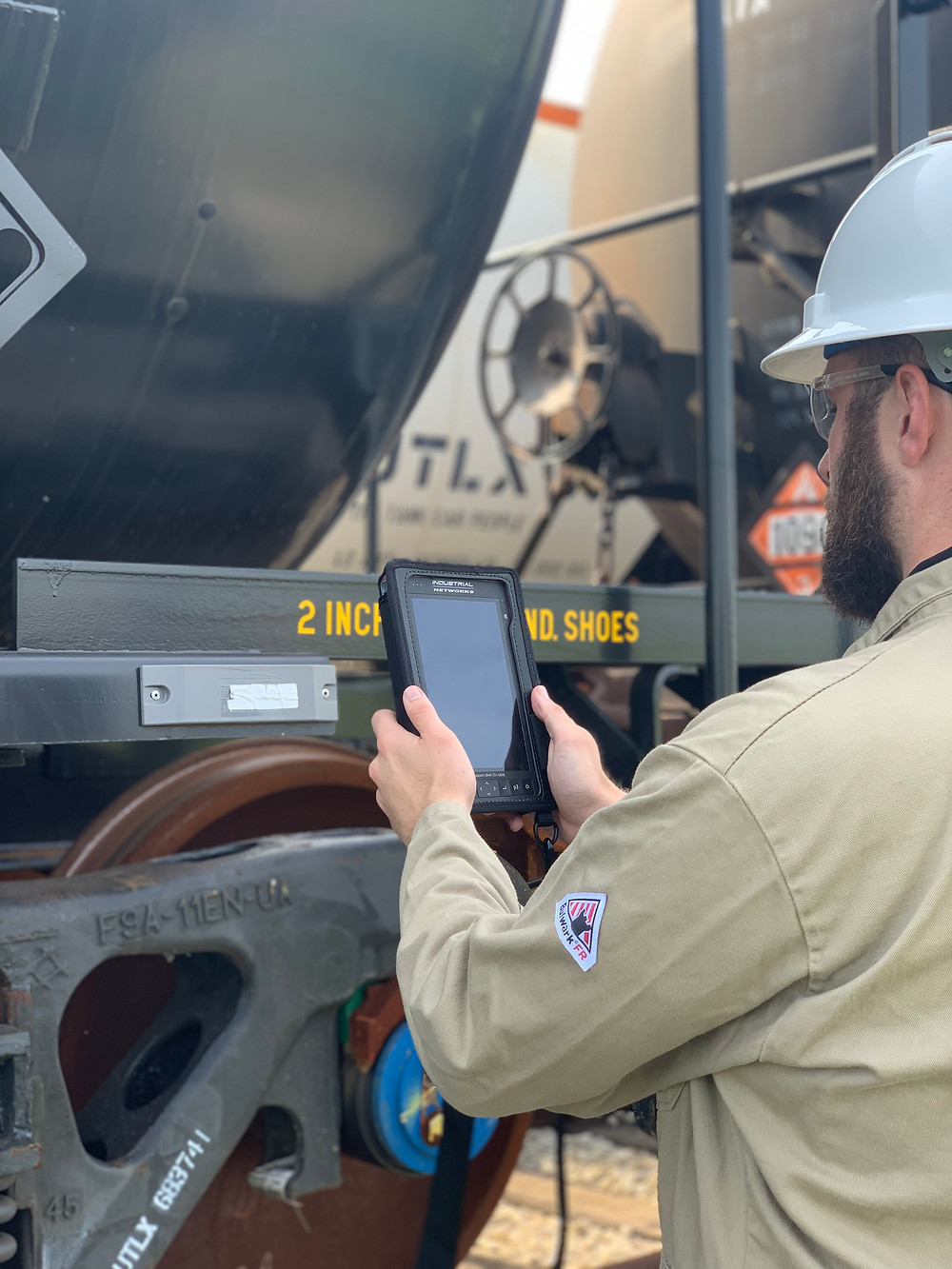 A railway operator reprograms an Automatic Equipment Identification (AEI) Tag mounted to a railcar.