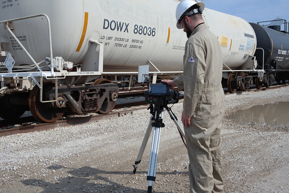 Operator using the INetRail PASS to scan tank cars on a rail track.