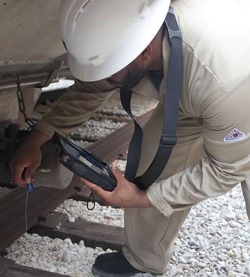 Rail operator using an INT300 tablet to scan a security seal.