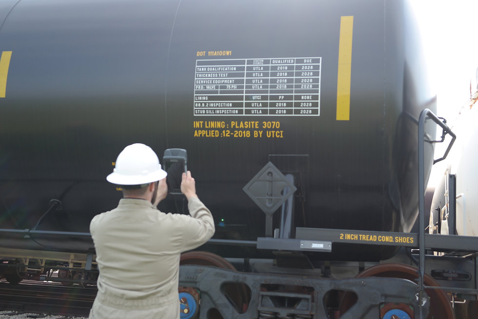 Operator scanning a railcar marking with an INT300 mobile AEI tablet.