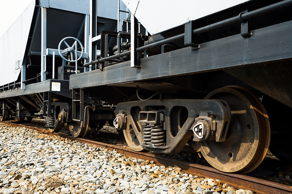 Close-up view of the bottom half of a railcar and its wheels.