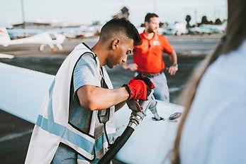 Man fueling plane.jfif