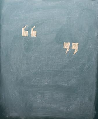 quotation mark on blackboard.jpg
