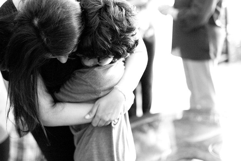 a mommy hugging her little boy.jpg