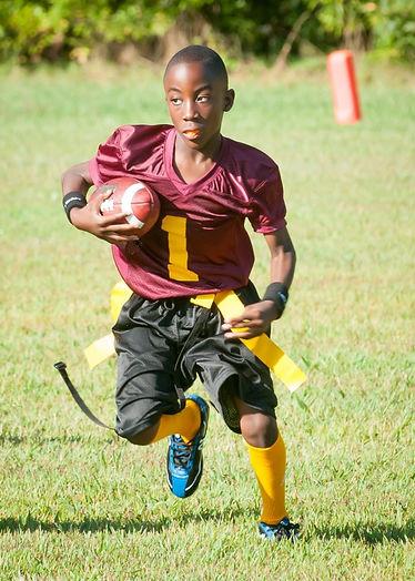 black kid flag football.jpg