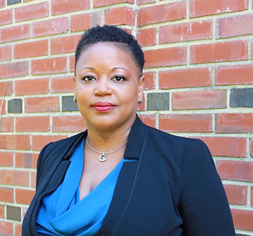 Profile picture of Dr. Keisha Bentley-Edwards standing in front of a brick wall