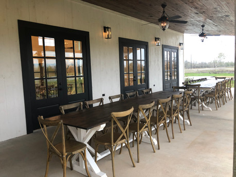 Farmhouse tables under lean-to