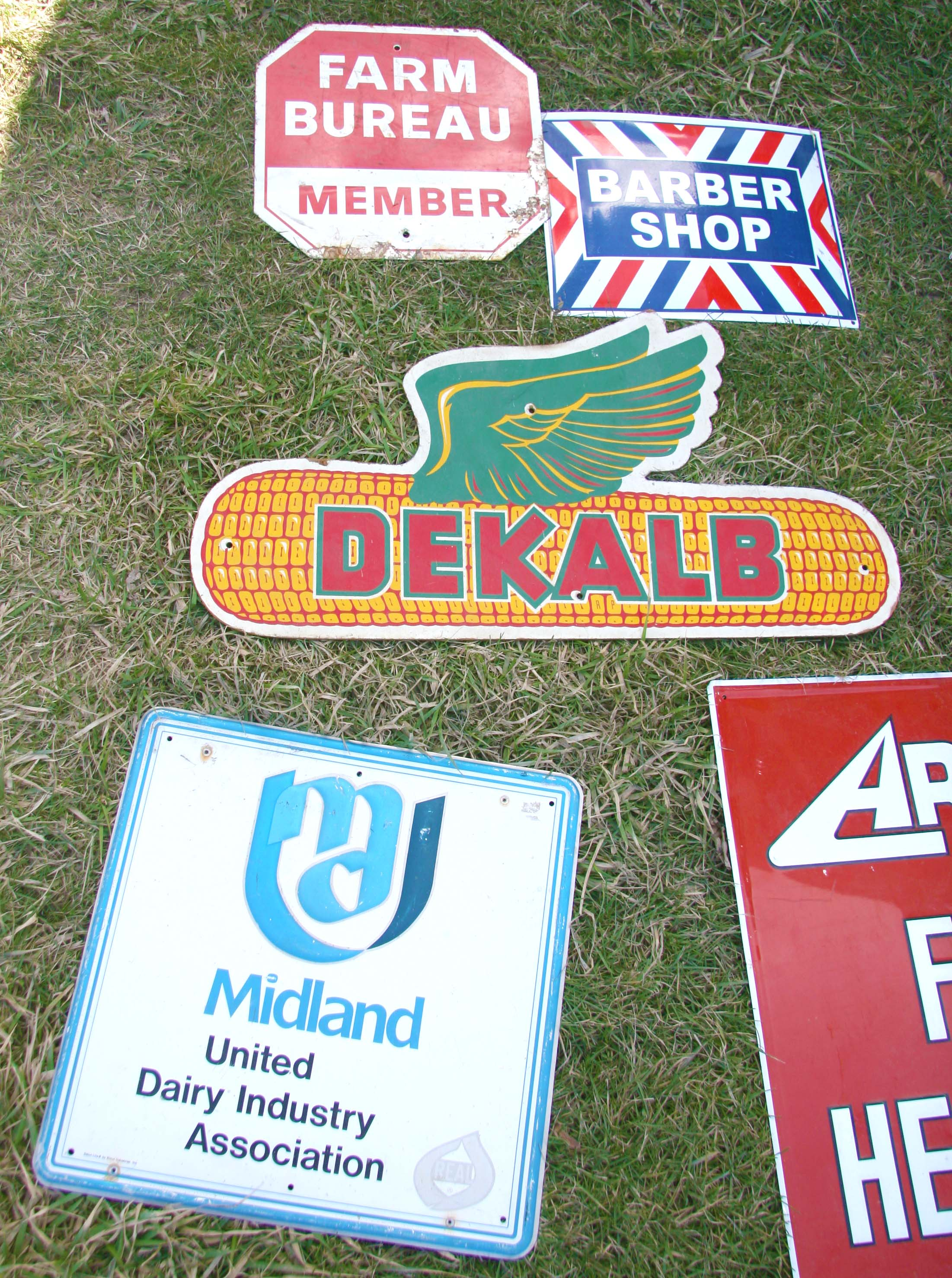 Familiar farm brands signs displayed at large farm event in Le Sueur, Minnesota