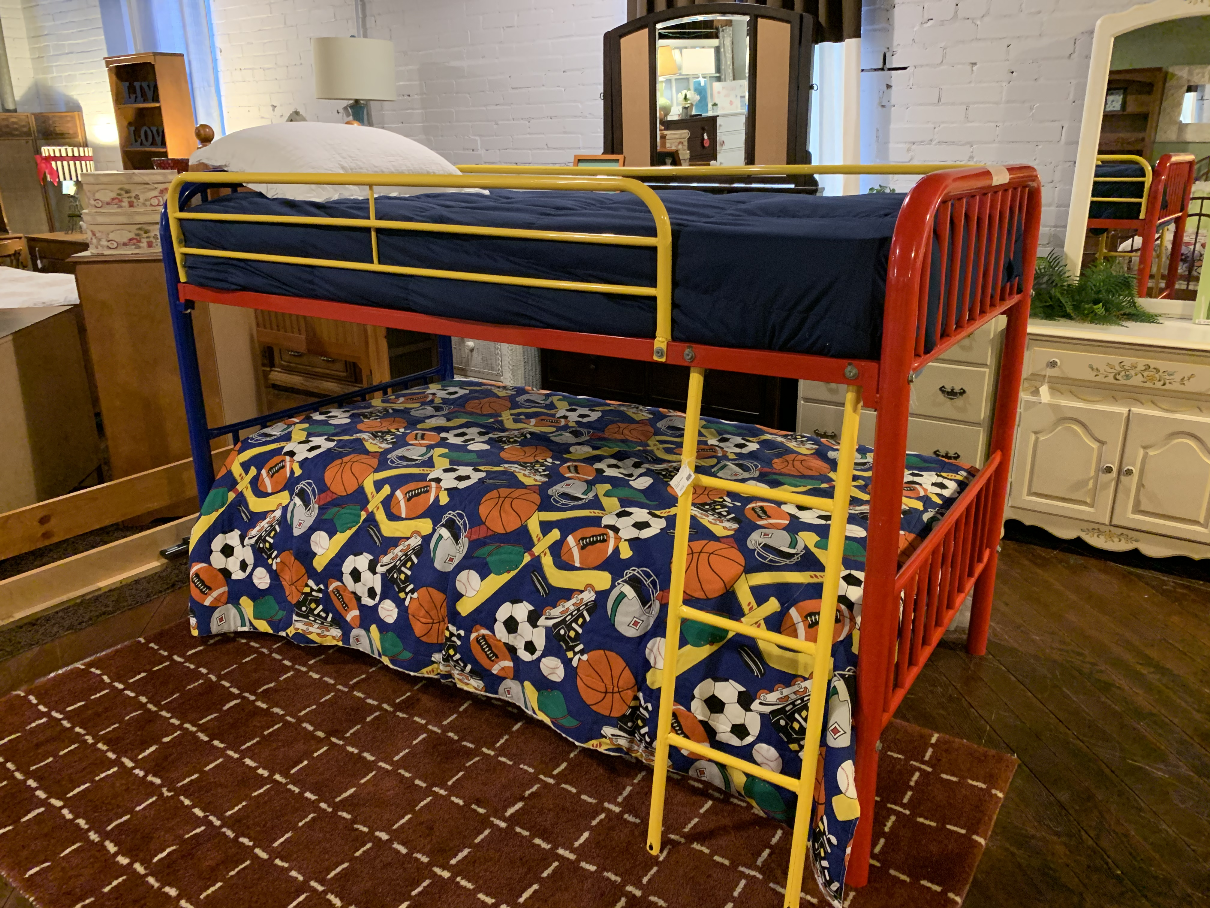 RED, BLUE, AND YELLOW TWIN METAL  BUNK BEDS