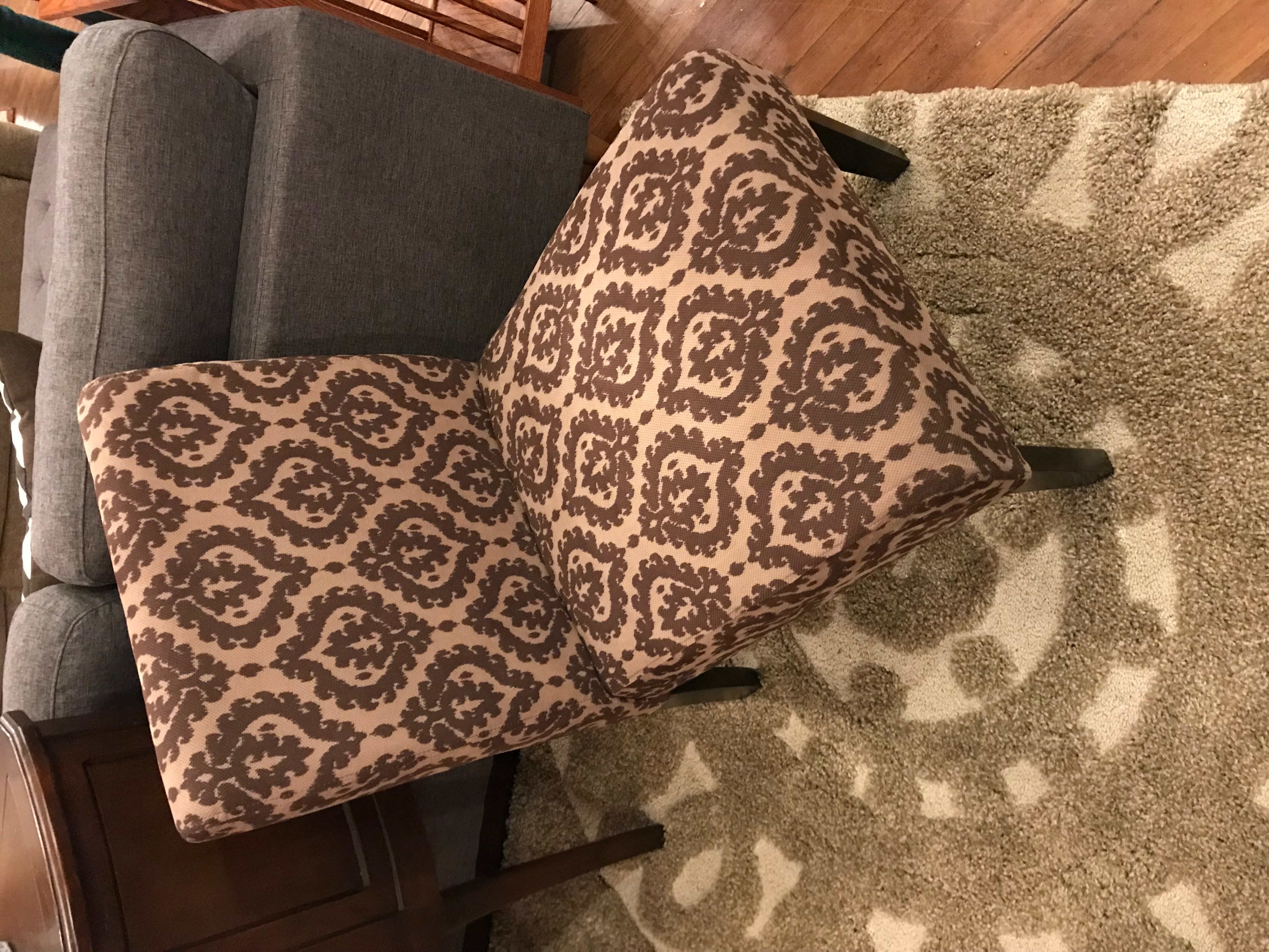 BROWN PATTERN ARMLESS CHAIR