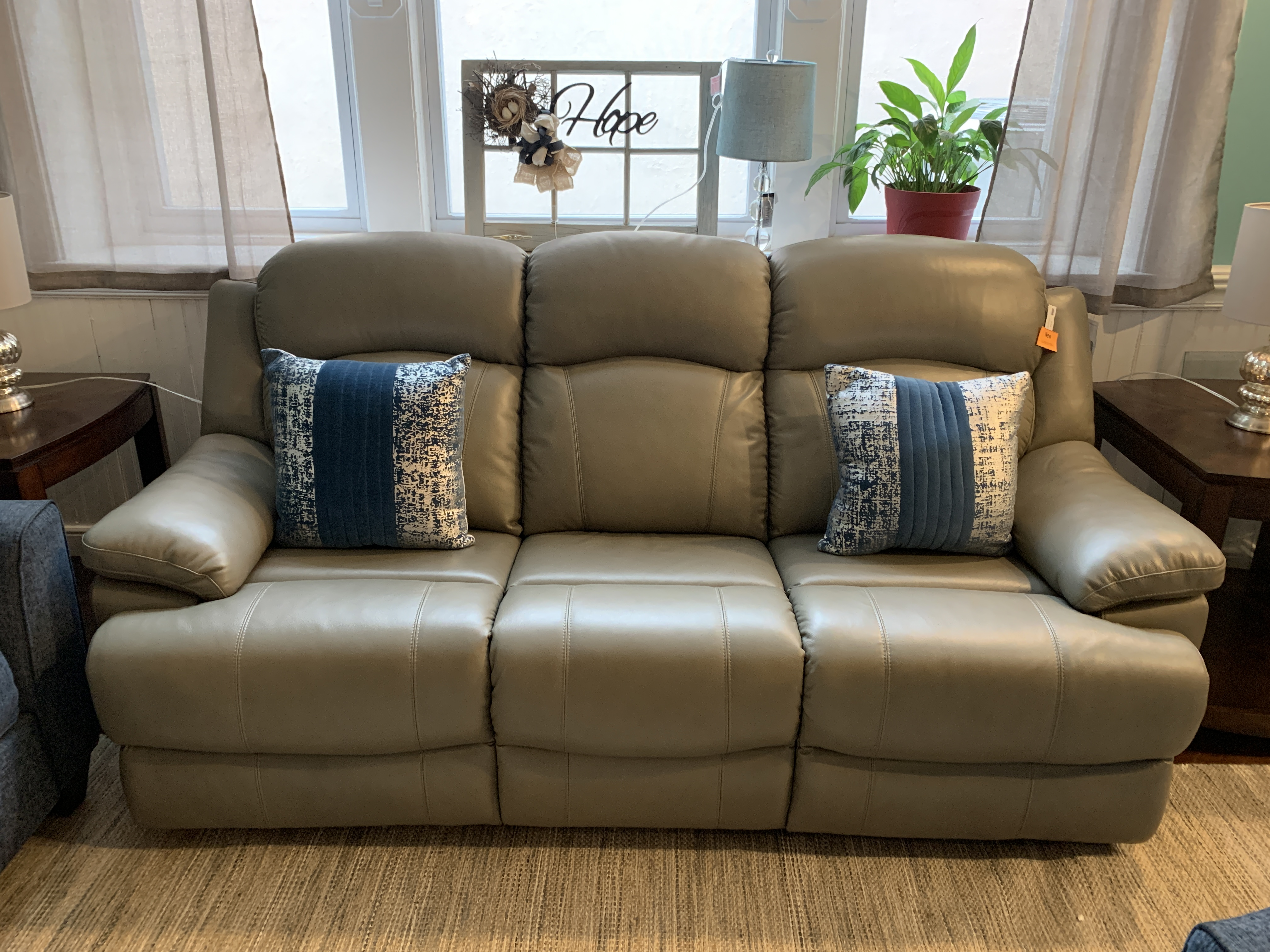 GRAY LEATHER DOUBLE RECLINING SOFA