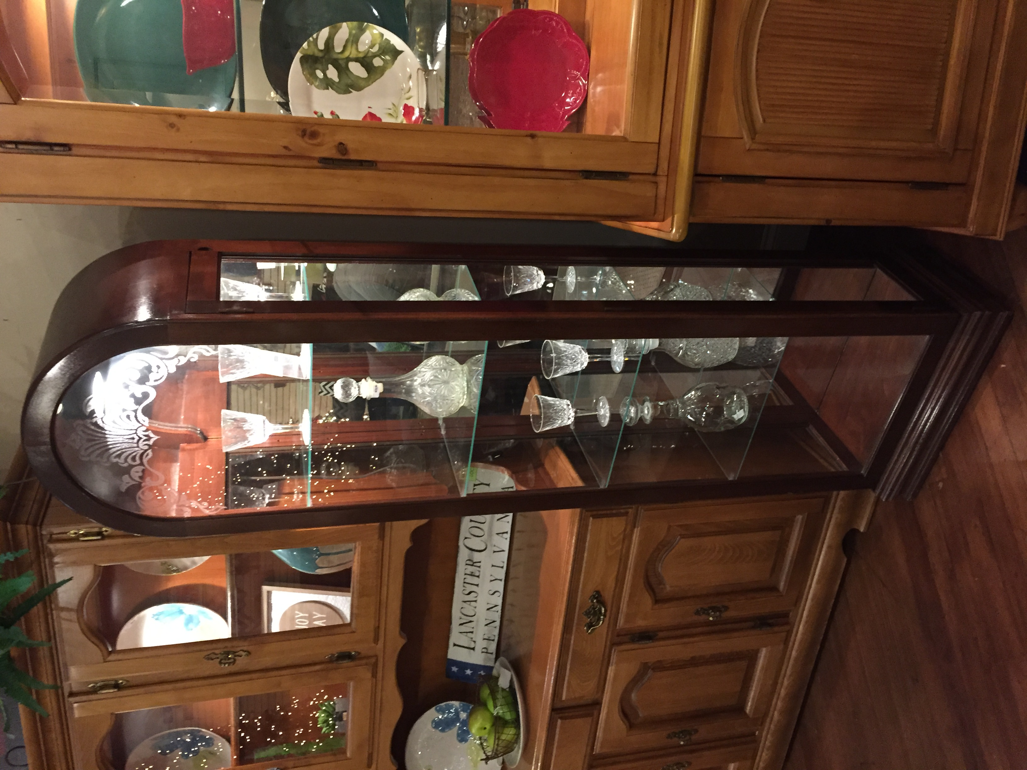 NARROW ARCHED CHERRY CURIO CABINET