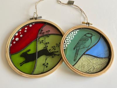 embroidery hoops with screen printed hare , plants, bird and text