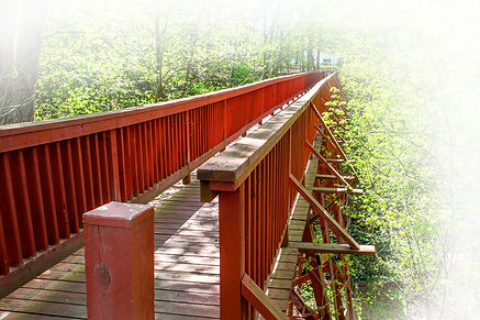 Image of red wooden footbridge