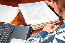 Woman author re-writing her manuscript a