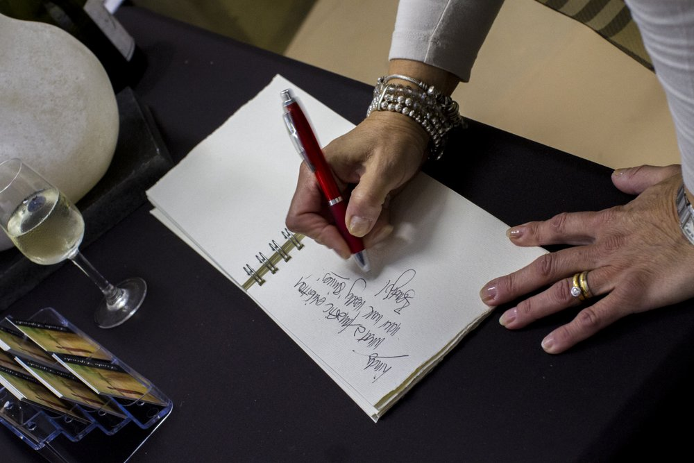 Signing her guest book