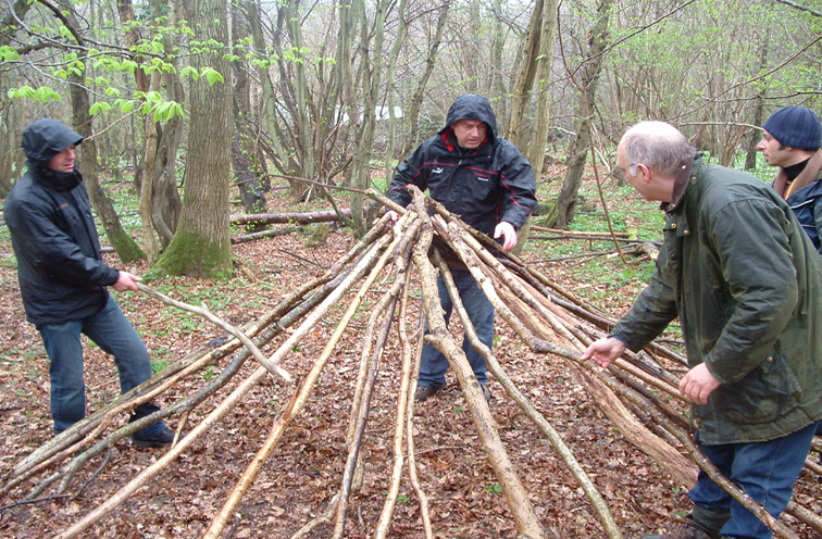 bushcraft team building shelter wood
