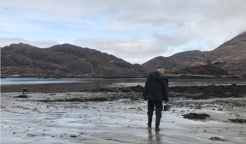 pictures of Leon walking at low tide looking for Razor Clams
