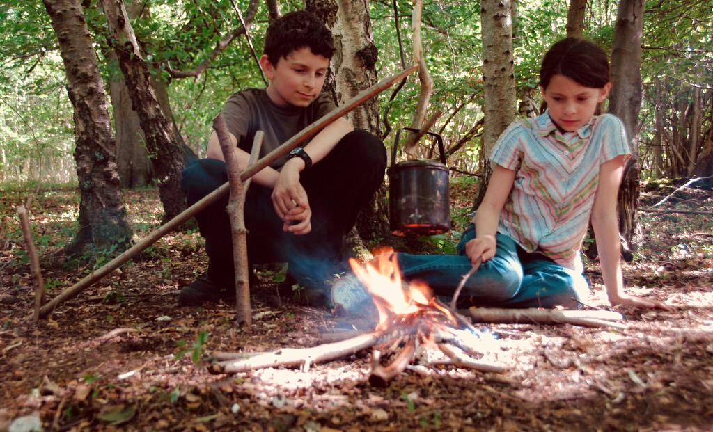 Family camping woodland fire