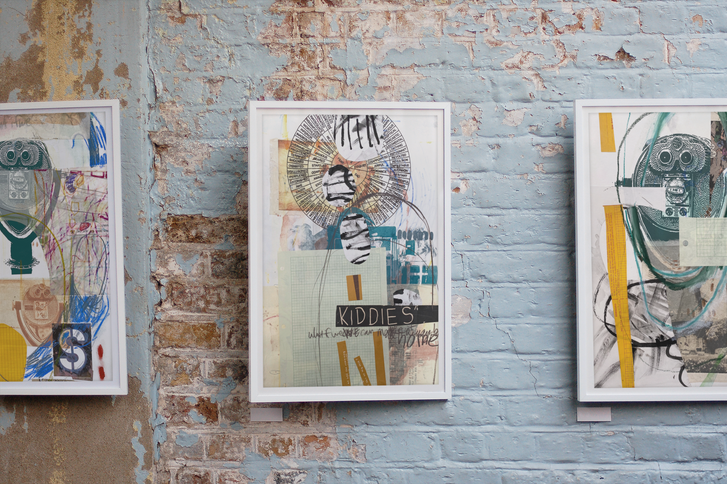 3 prints on a brick wall