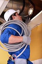 Electrician wiring an industrial loft sp